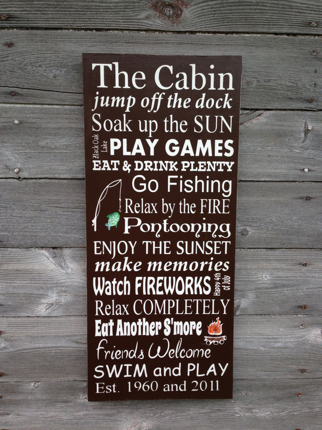 Add Sophisticated Style To Your Lake House With This Charming Personalized Metal Sign Featuring A Wood Grain Motif And
