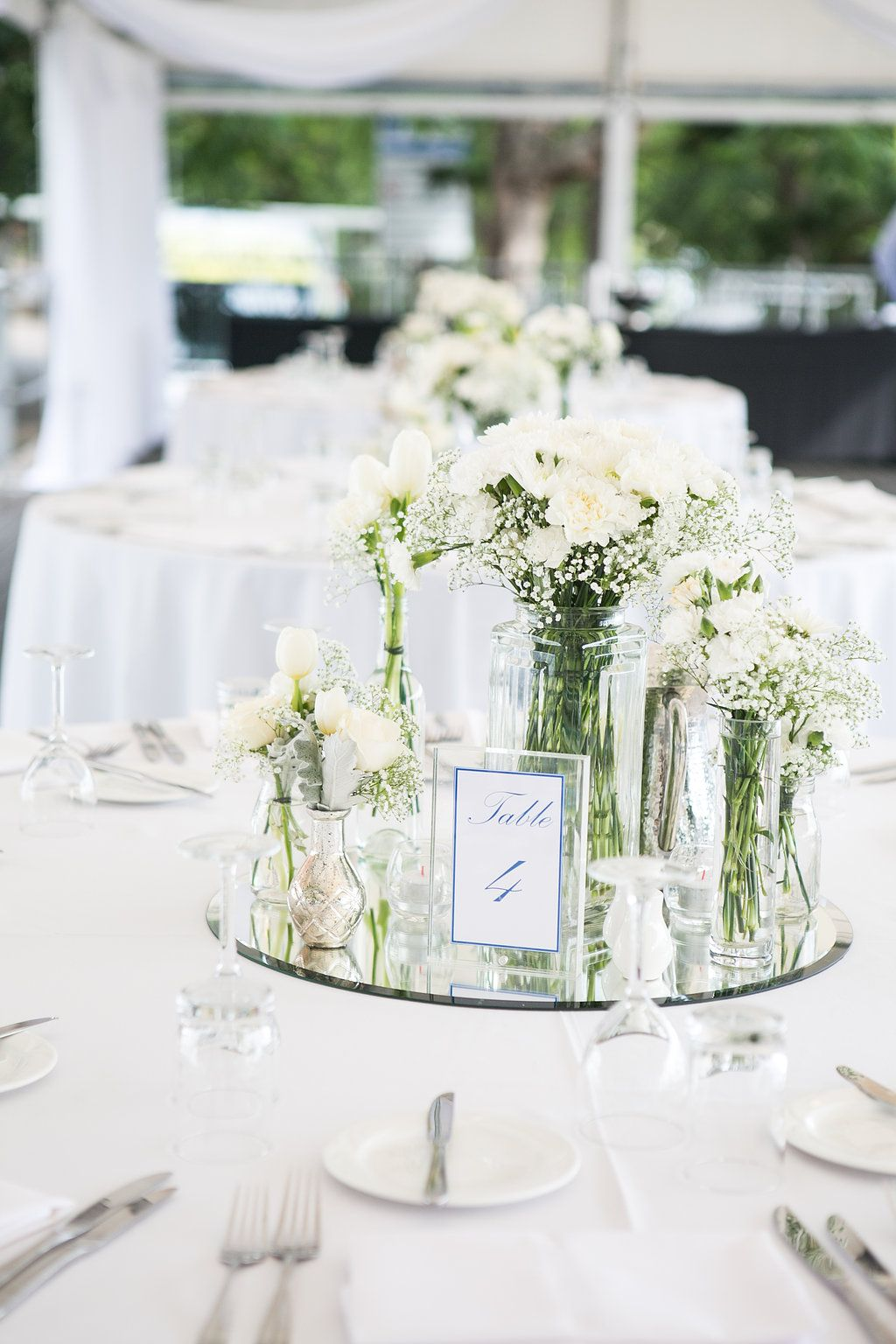 White wedding table flowers Mirror base white table