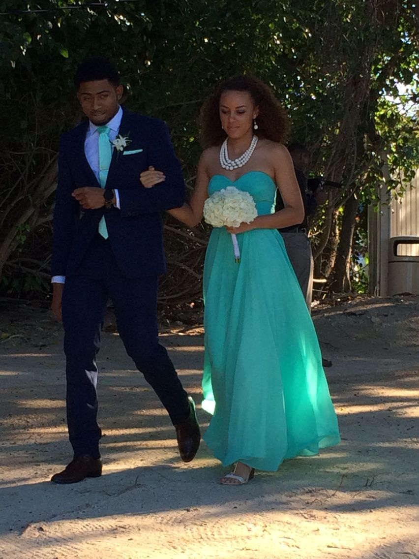 Groomsman in navy suit and bridesmaid in mint green dress...for our ...
