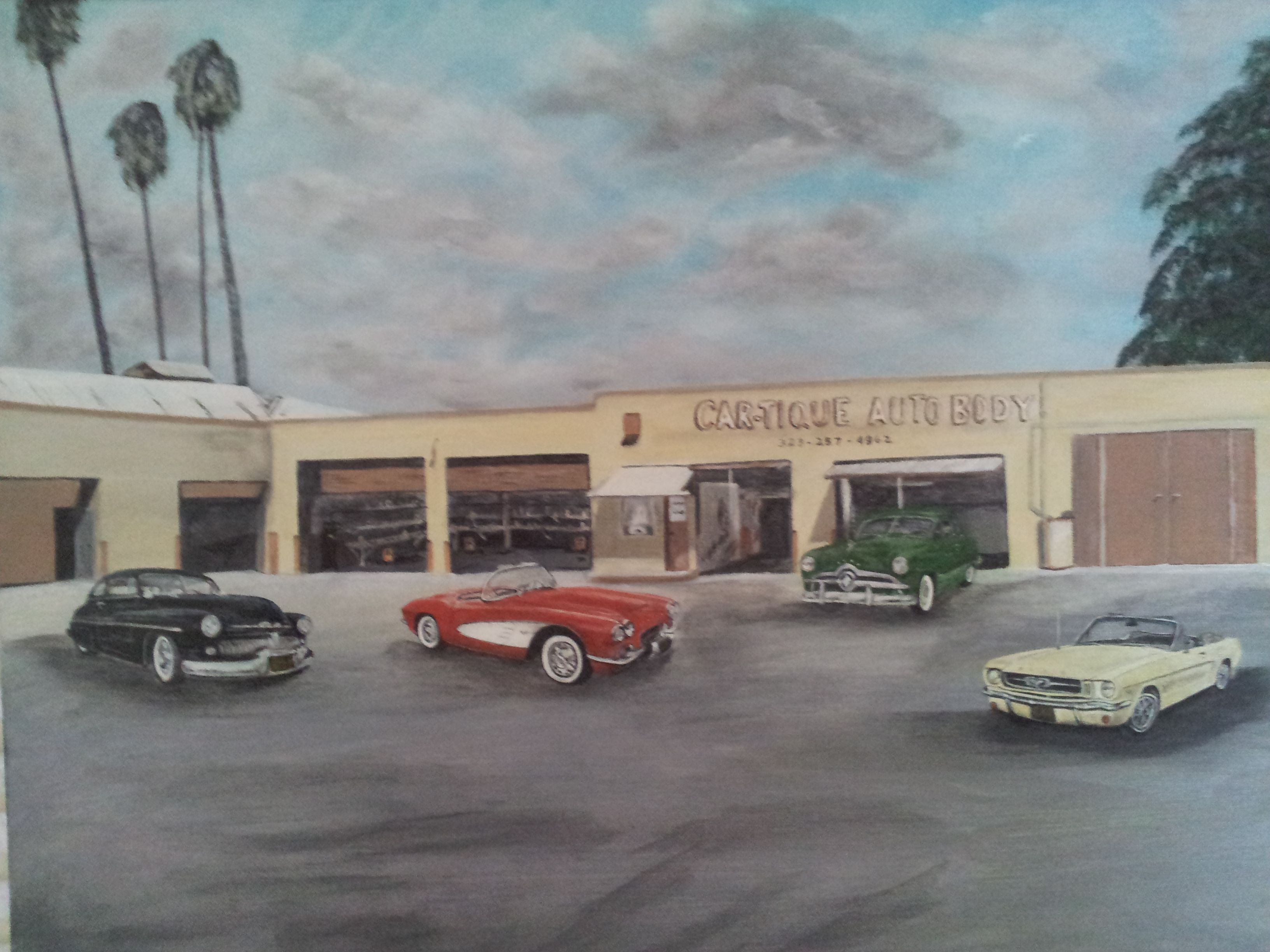 Sonny & Bev's Auto Body Shop with four of their classic cars.