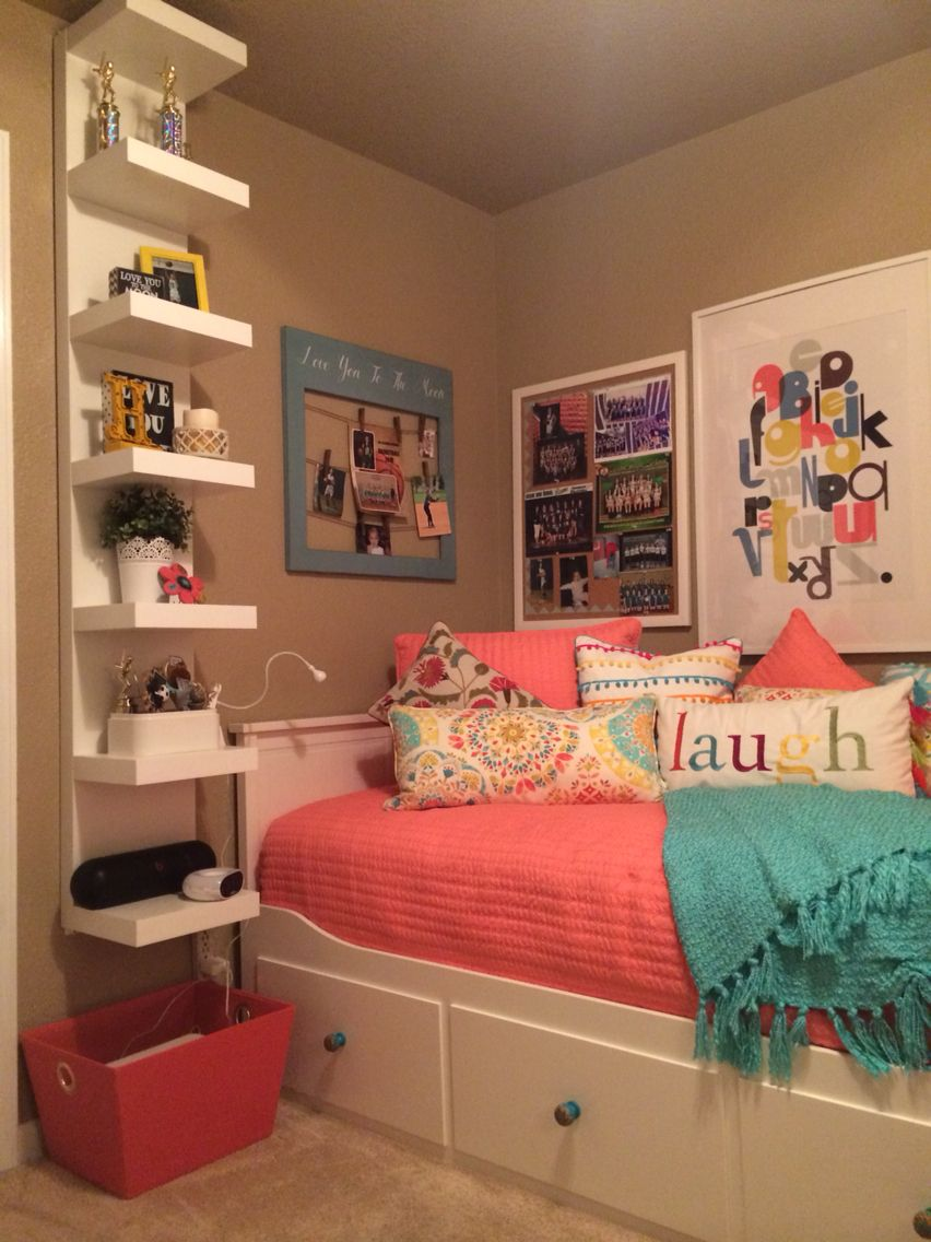 Teenage daughter's complete small coral and teal bedroom