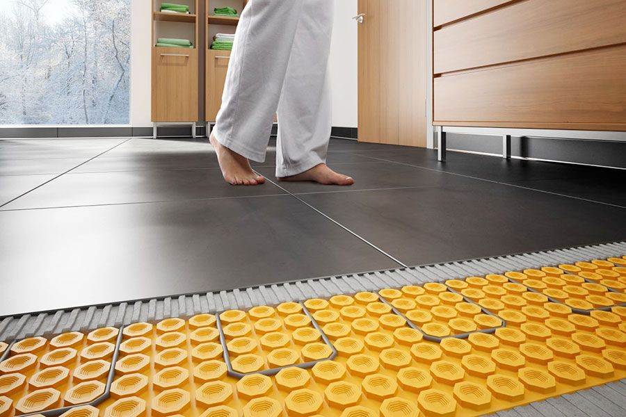 Who Hasn T Bought A Pair Of Slippers Just To Escape The Cold Hard Floor Of Their Bathroom With Heated Underfloor Tiles Slippe Heated Tile Floor Heated Concrete Floor Flooring