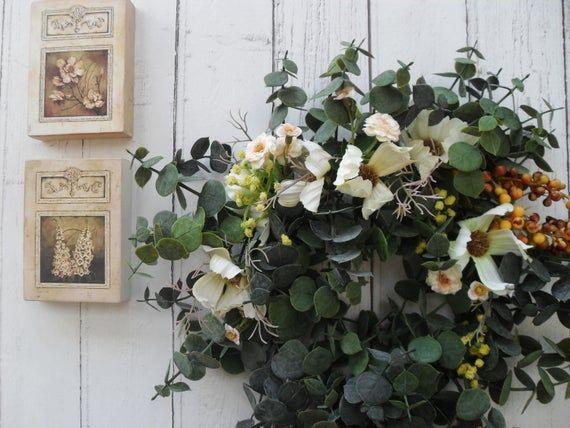 Photo of Eucalyptus wreath, artificial flower decor, artificial flowers