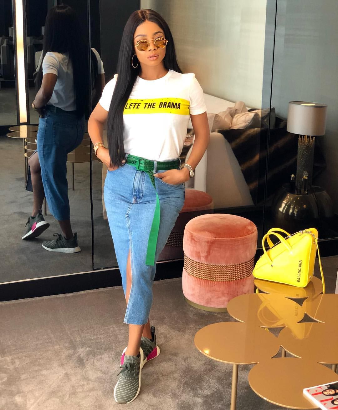 cd4fec88b5c2 Off- White X Adidas X Linda Farrow 💛💛💛. Dripping drip drip. Toke makinwa  in denim skirt. How to wear denim skirt. How to wear jeans skirt.