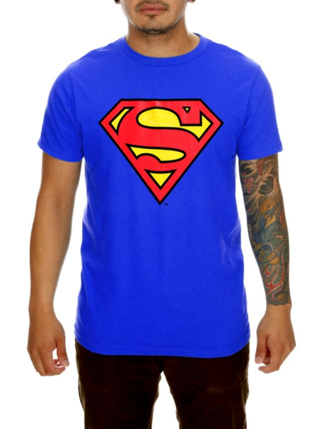 This blue T-shirt features the classic Superman logo screened on the front. Now where's that telephone booth?