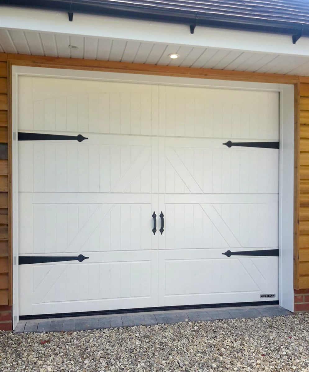 A Hormann Lth42 Style 405 Nordic Pine Sectional Garage Door Finished In Limestone White Garage Doors Sectional Garage Doors White Garage Doors