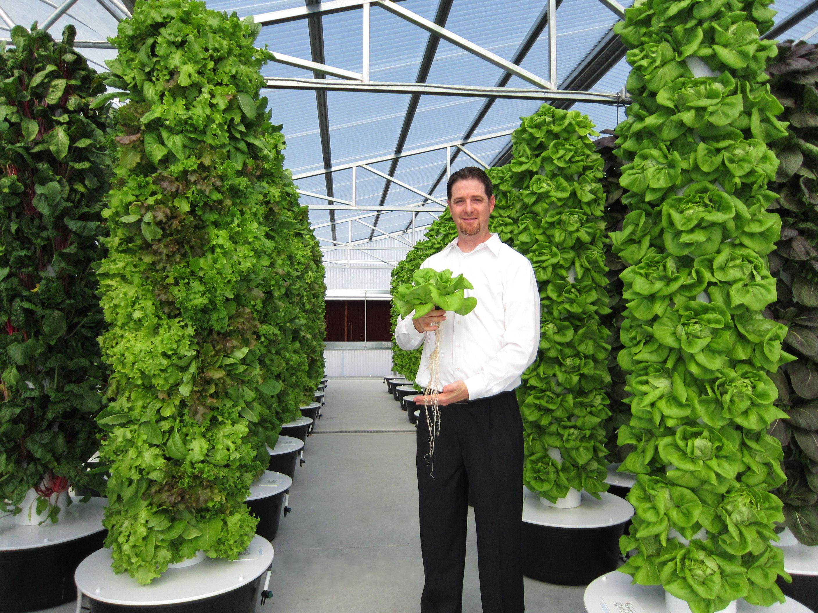 Tim Blank, founder and CEO of Future Growing, holds