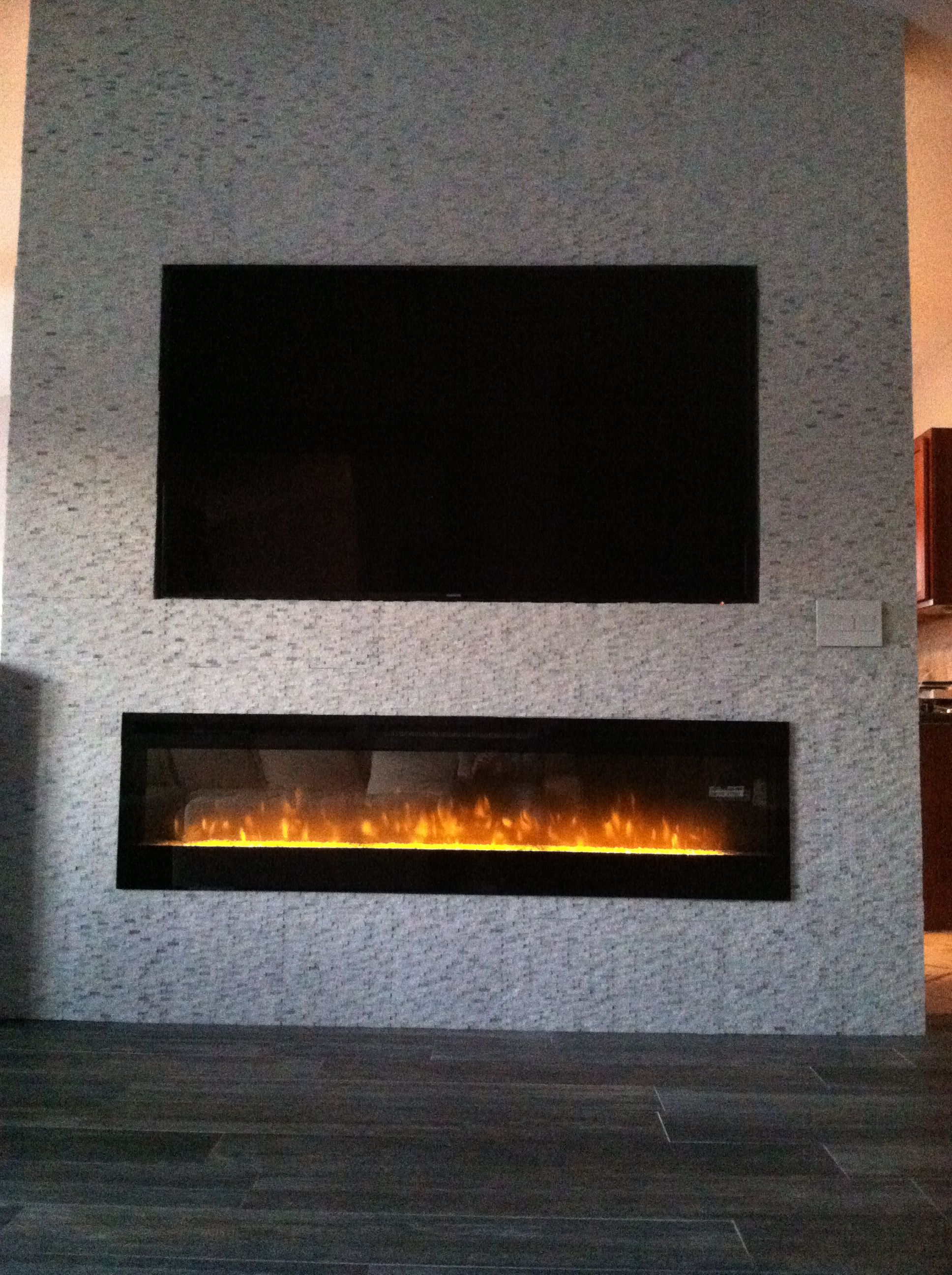 Stacked stone tumbled polished marble tv fireplace wall walls lights pinterest tv - Fireplace wall ...