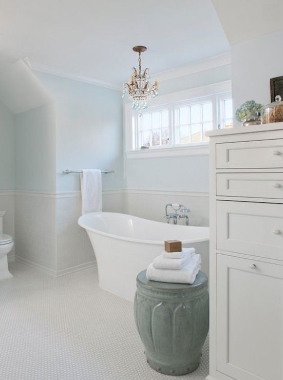 marianne jones: lovely white and blue master bath features powder blue walls paired with light