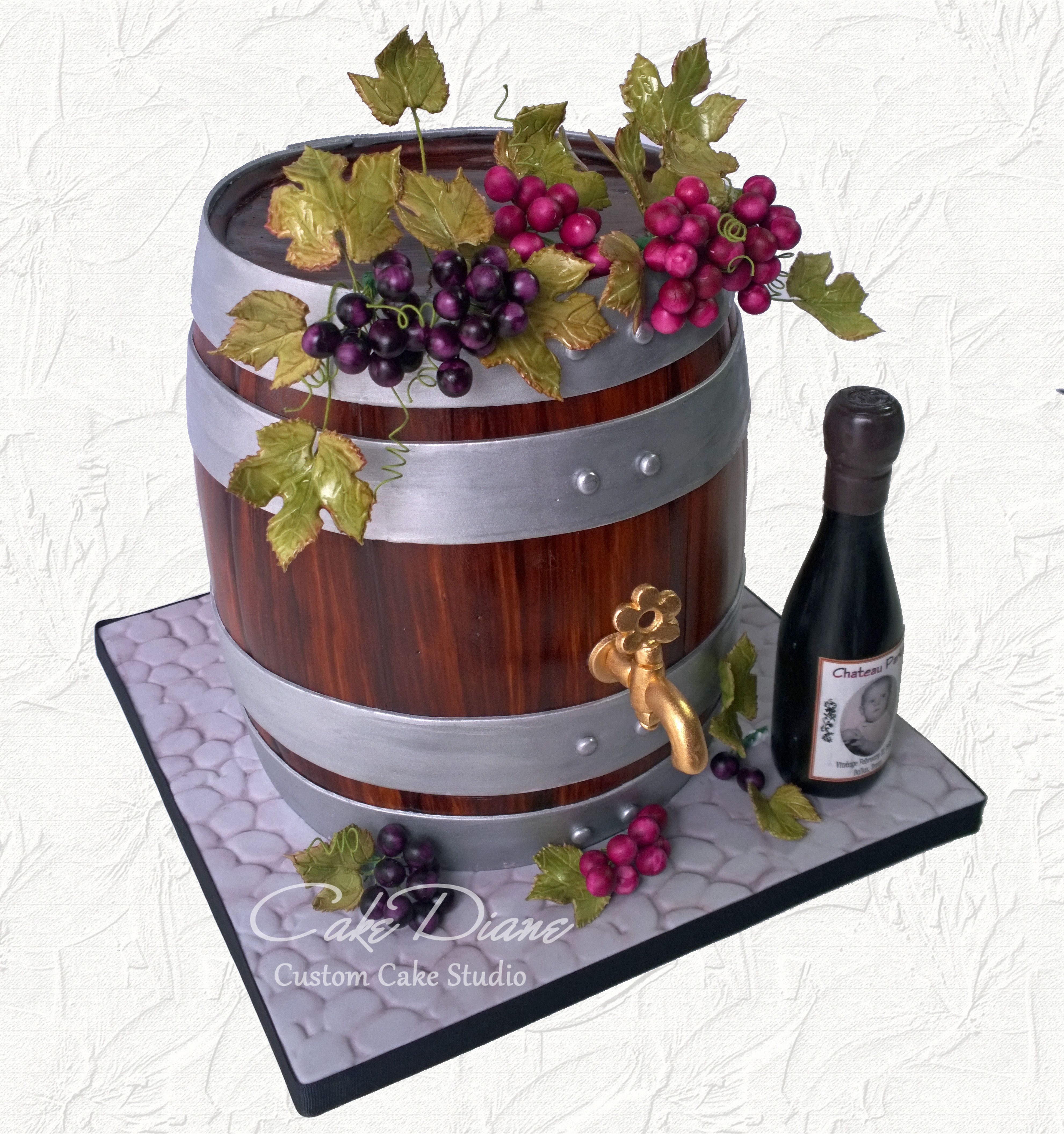 Wine Barrel Cake With Grape Clusters And Chocolate Bottle With Custom Label