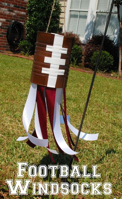 Decorate with football windsocks made from painted tin cans. | 39 Clever Tailgating DIYs To Get You In The Spirit