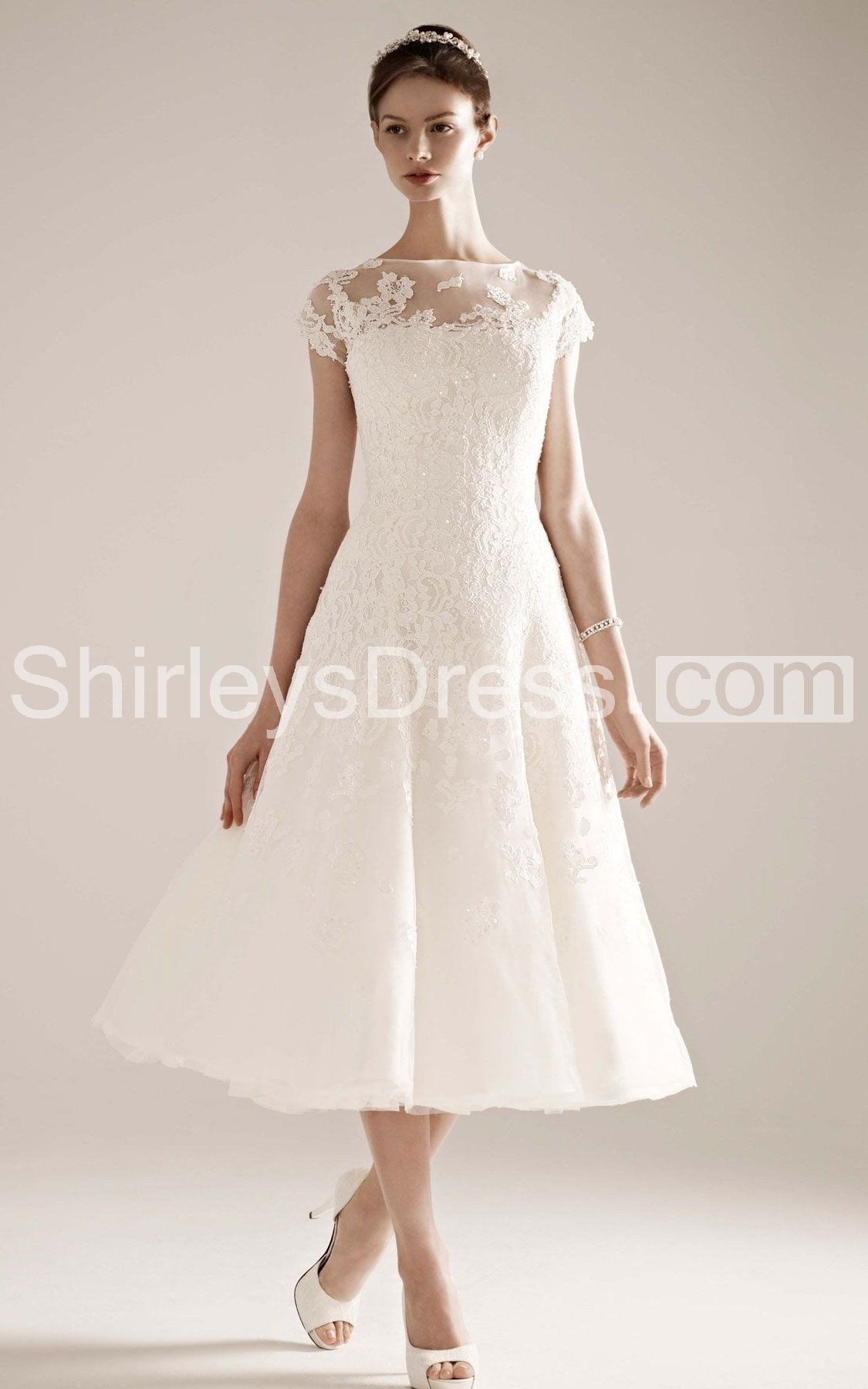 Modern capsleeve dress with illusion neckline and beaded lace
