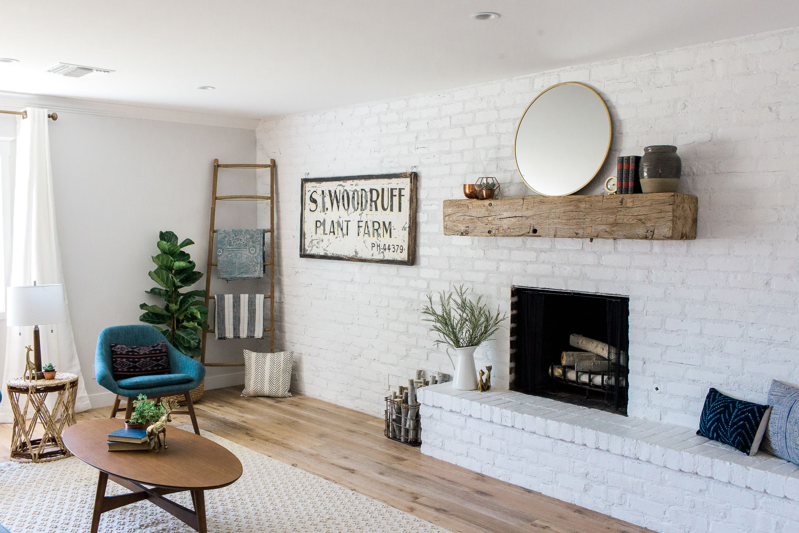 Family Room Accent Wall With White Painted Brick Wall And Barn Wood Mantel Brick Wall Living Room White Brick Wall Living Room Living Room White #paint #living #room #accent #wall