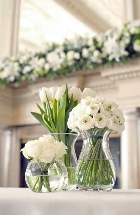 Simply white. Tulips, lisianthus and roses. All in season in July.