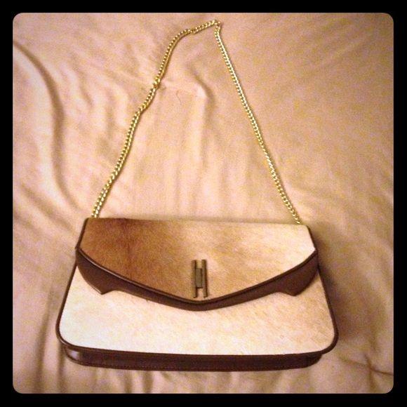 Vintage Genuine Fur Cowhide Purse Vintage Genuine Fur Cowhide purse with chain accent. Purse fits over the shoulder. Tan/white. Pocket on inside. Vintage Bags Shoulder Bags