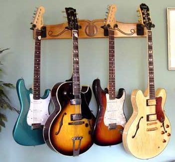 the pro file wall mounted guitar hanger wall mount guitar hangers. Black Bedroom Furniture Sets. Home Design Ideas
