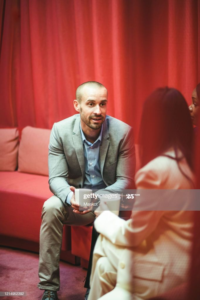 Business Colleagues Discussing During Coffee Break While Sitting On Sofa In Offi #Ad, , #AFFILIATE, #Discussing, #Coffee, #Business, #Colleagues