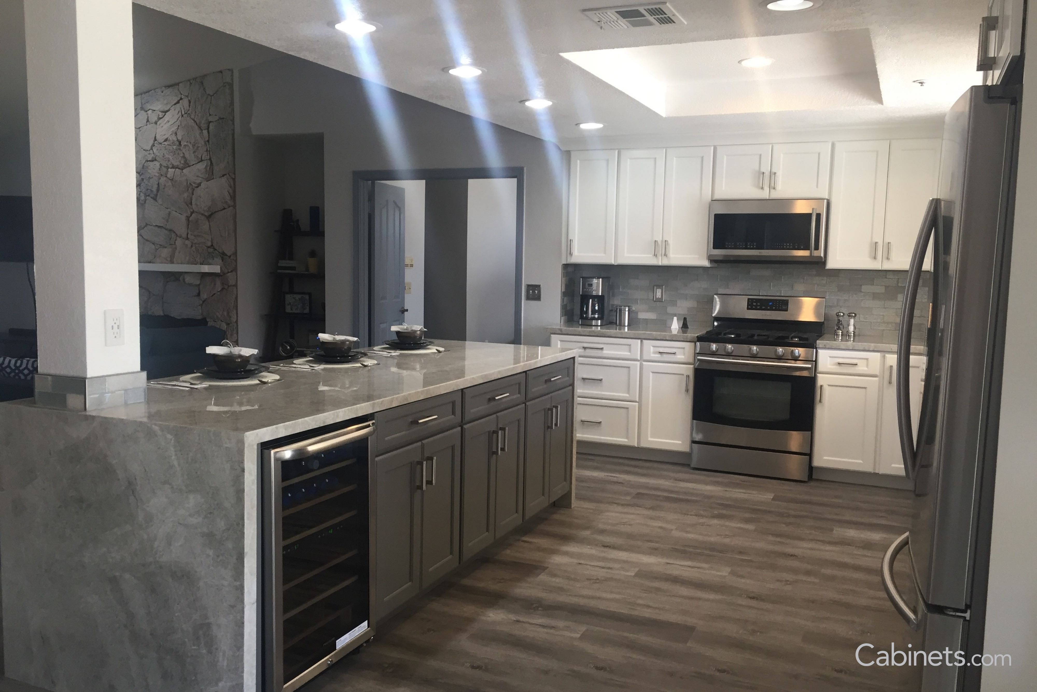 This Open Kitchen Features A Grey Waterfall Island Buy Kitchen Cabinets Online Online Kitchen Cabinets Buy Kitchen Cabinets