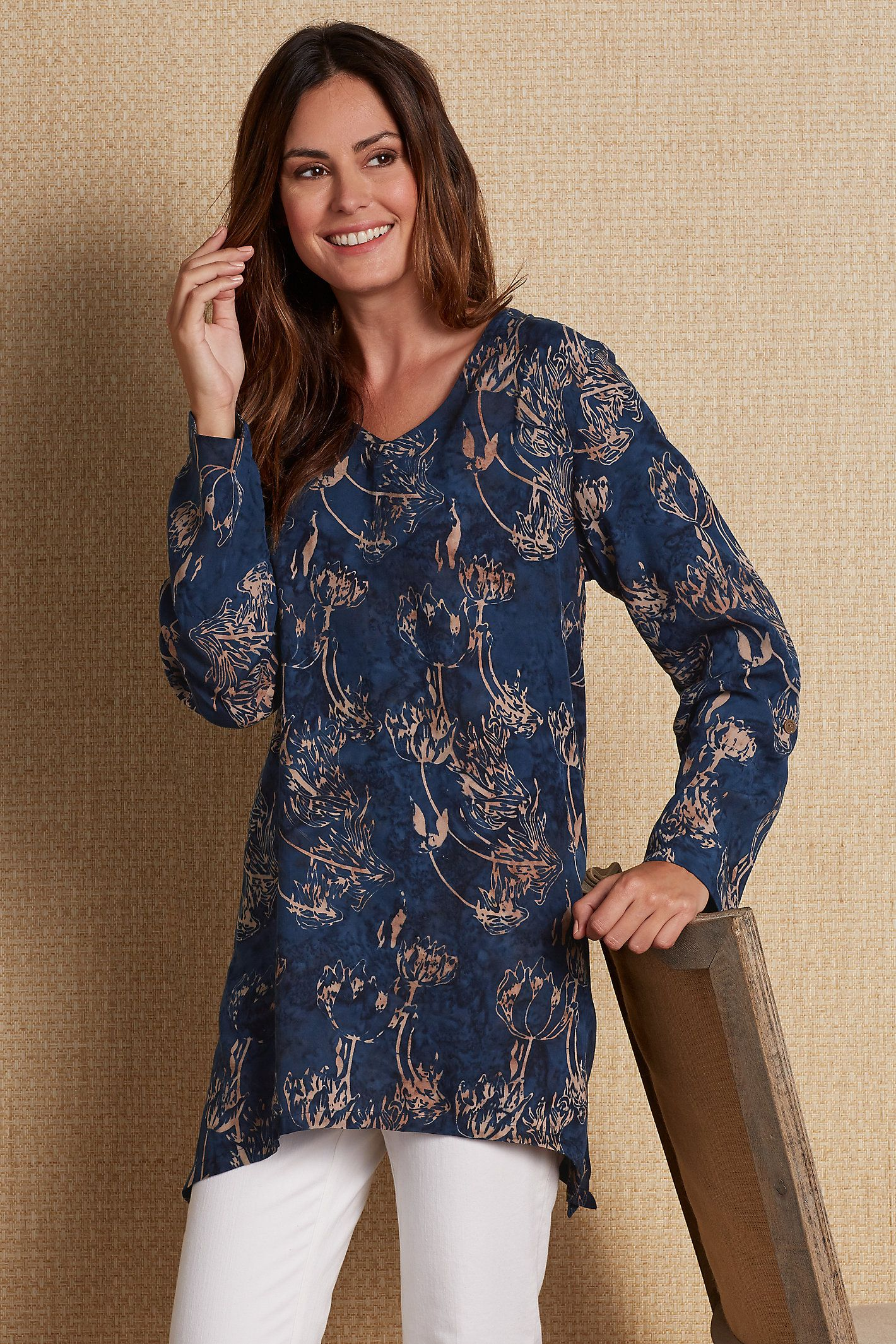 Exotic flowers seem to gently sway in this artful batik print Grace Tunic top of soft and drapey rayon, fashioned with a contrast border print.