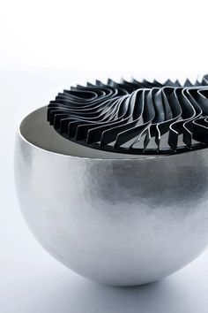 Sidsel Dorf-Jensen's honecombed, hollowware, shows a purity of the material, silver. She lives in Denmark. See Blogroll for a link to her site. | Decanted