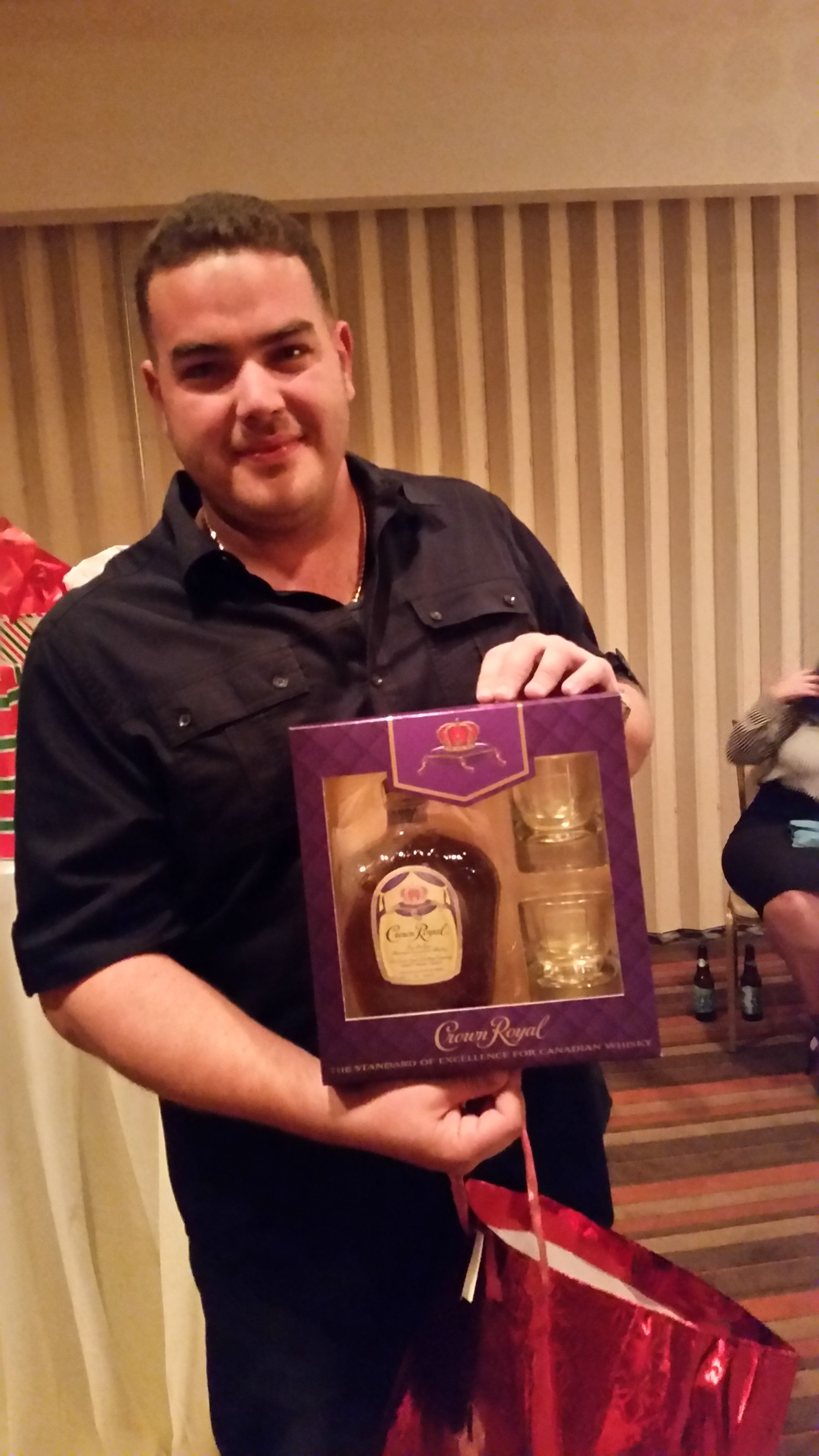 Our Director of Search Engine Marketing, Manny with his gift from the 2015 #TeamRand Holiday Party