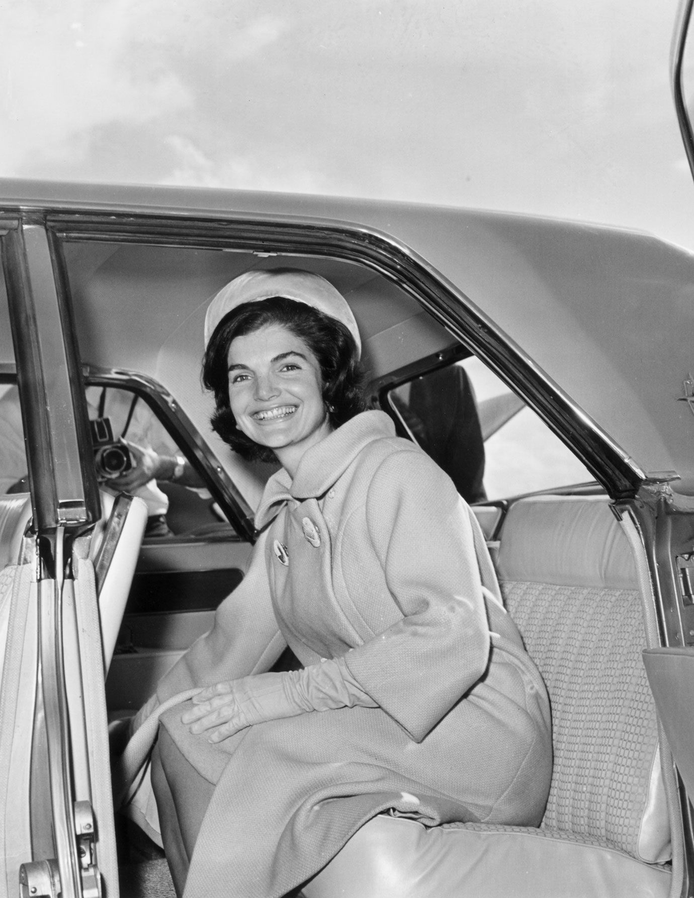 a45bd092af03 January 1961- Jacqueline Kennedy sits in the back seat of a car in Palm  Beach.