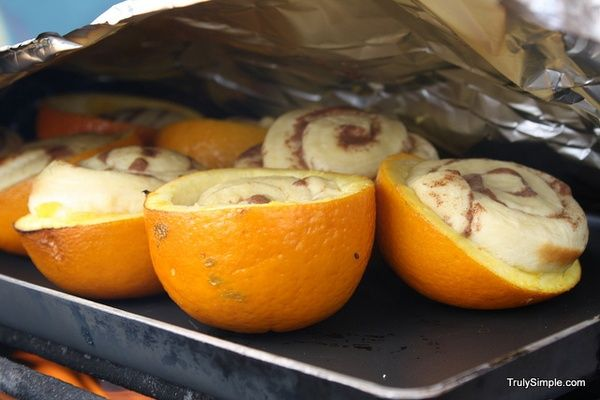 Bake a package of cinnamon rolls in orange shells over the campfire.