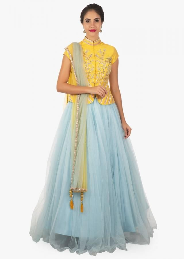 b0e693c3736ce7 Yellow peplum top paired with a sky blue lehenga and shaded dupatta only on  Kalki