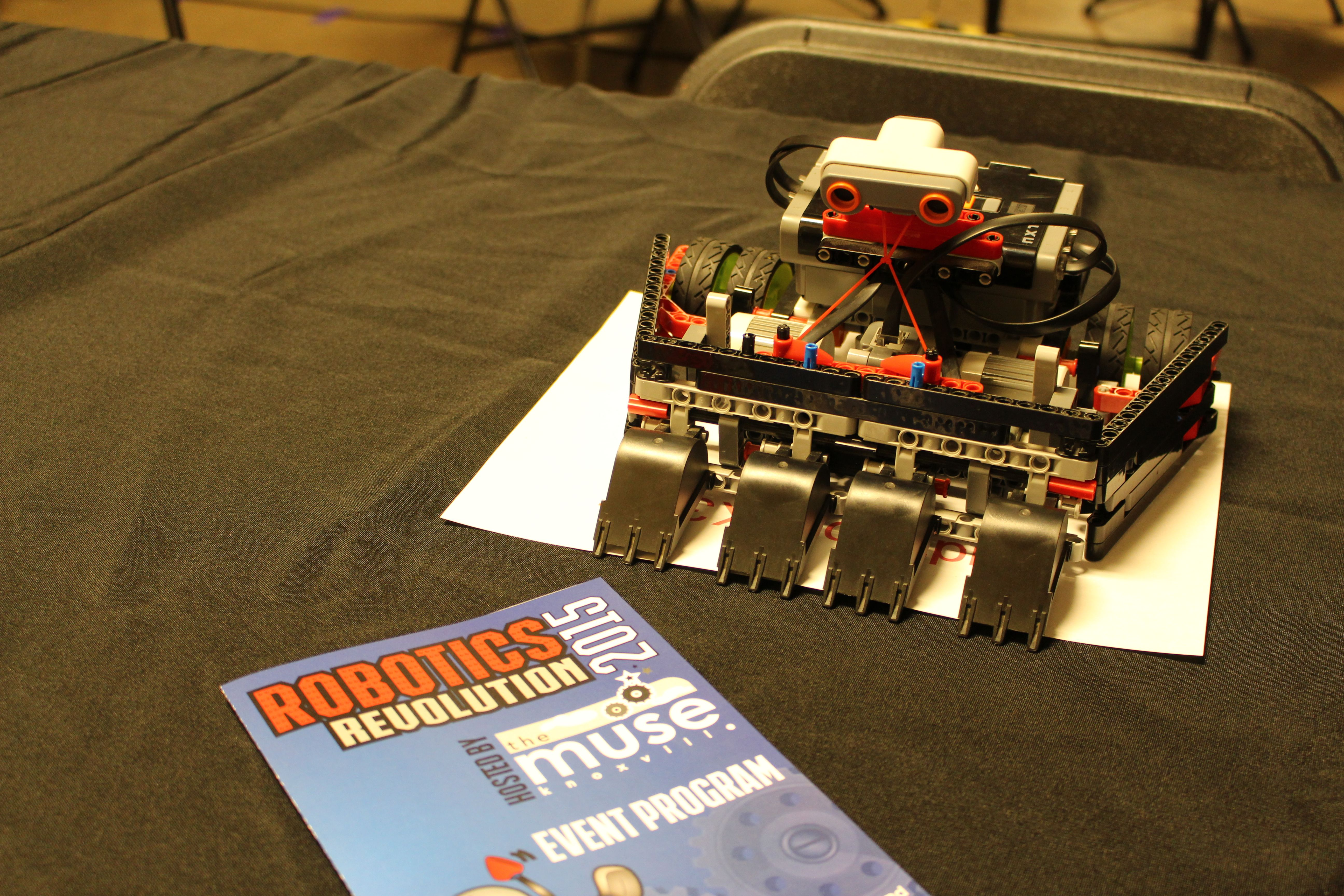 An eight-year-old boy attends Robotics Revolution sponsored by The Muse and writes about some of the robots on display and one special little robot.