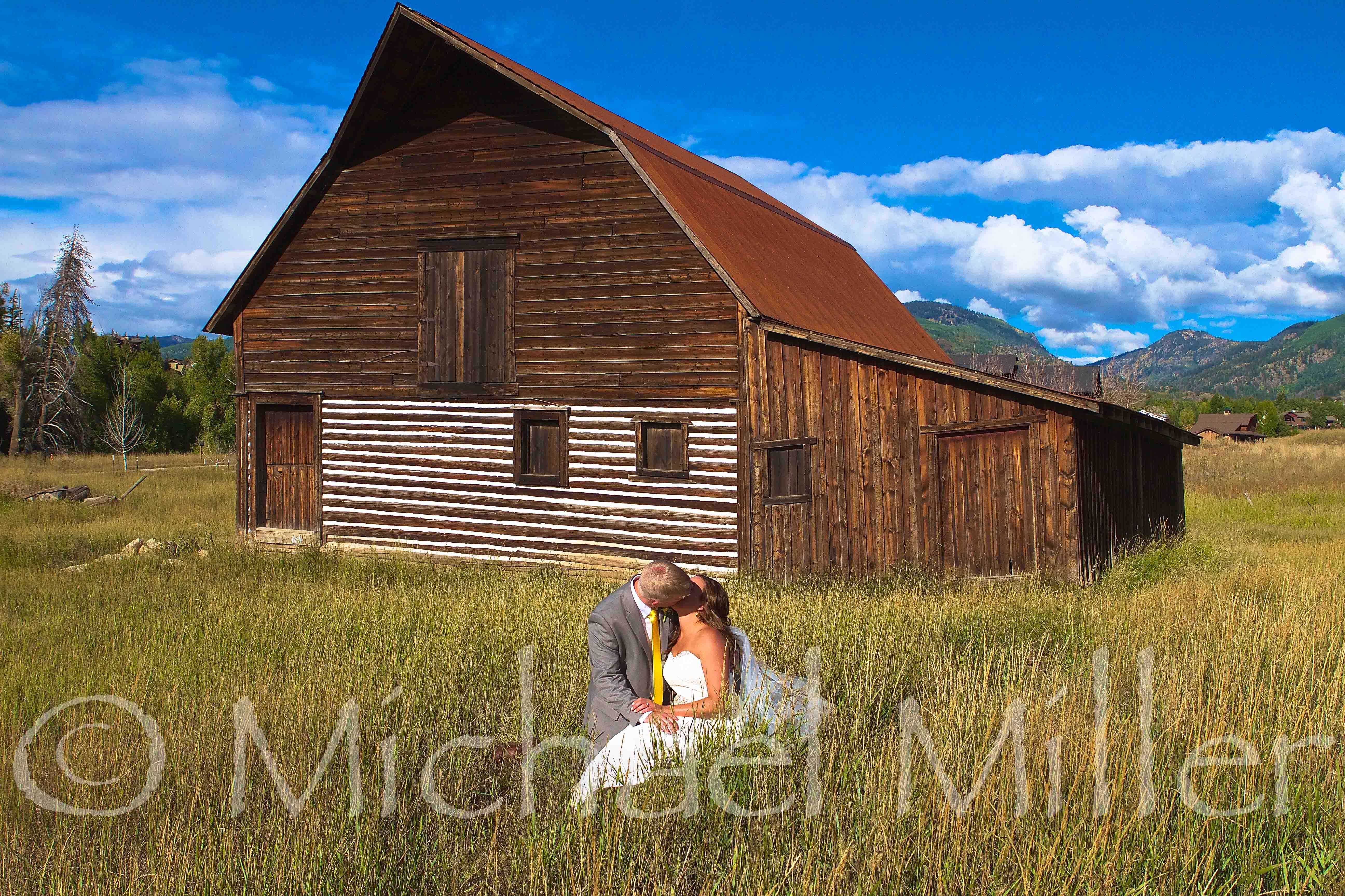 Enjoying a sweet kiss in front of the famous wooden barn ...