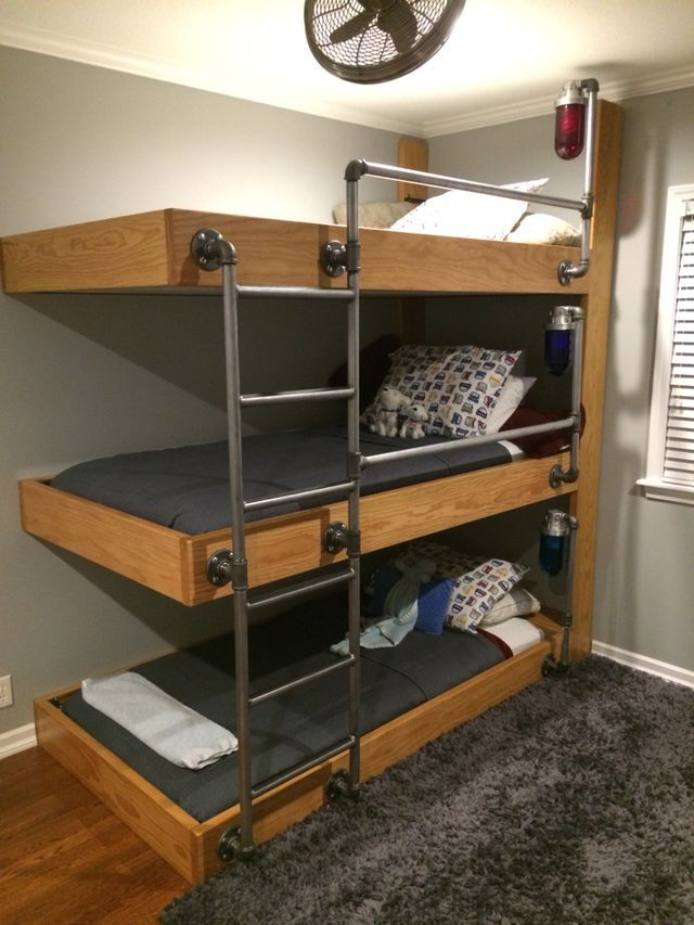 the triple bunk beds made out of vintage explosion proof globes u0026 hardware which was the finishing touch each bed has their own shelves light switch