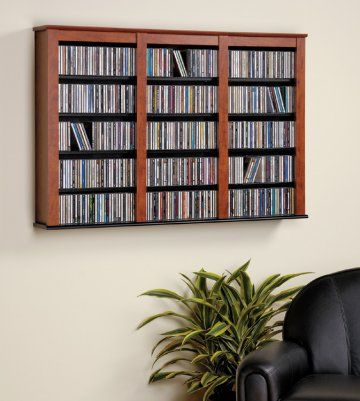 The Cherry and Black Triple Wall Mounted Storage Shelf by Prepac is designed to manage a large collection of CDs or DVDs with style. Mount on your wall as a stand-alone decor piece or above a complementary piece to make your collection easily accessible. Wall mounted storage is ideal when floor space is limited, and with our easy to hang system can be mounted at any height to best suit your room requirements.