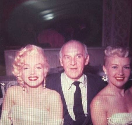 Marilyn with Betty Grable and Walter Winchell at a birthday party for Winchell at Ciro's Nightclub, May 13, 1953.