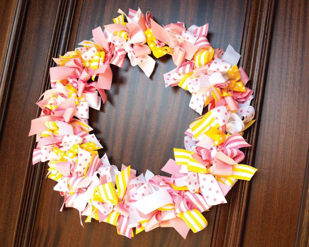 Pretty ribbon wreath from a Curious George girl birthday party! See more party planning ideas at CatchMyParty.com!