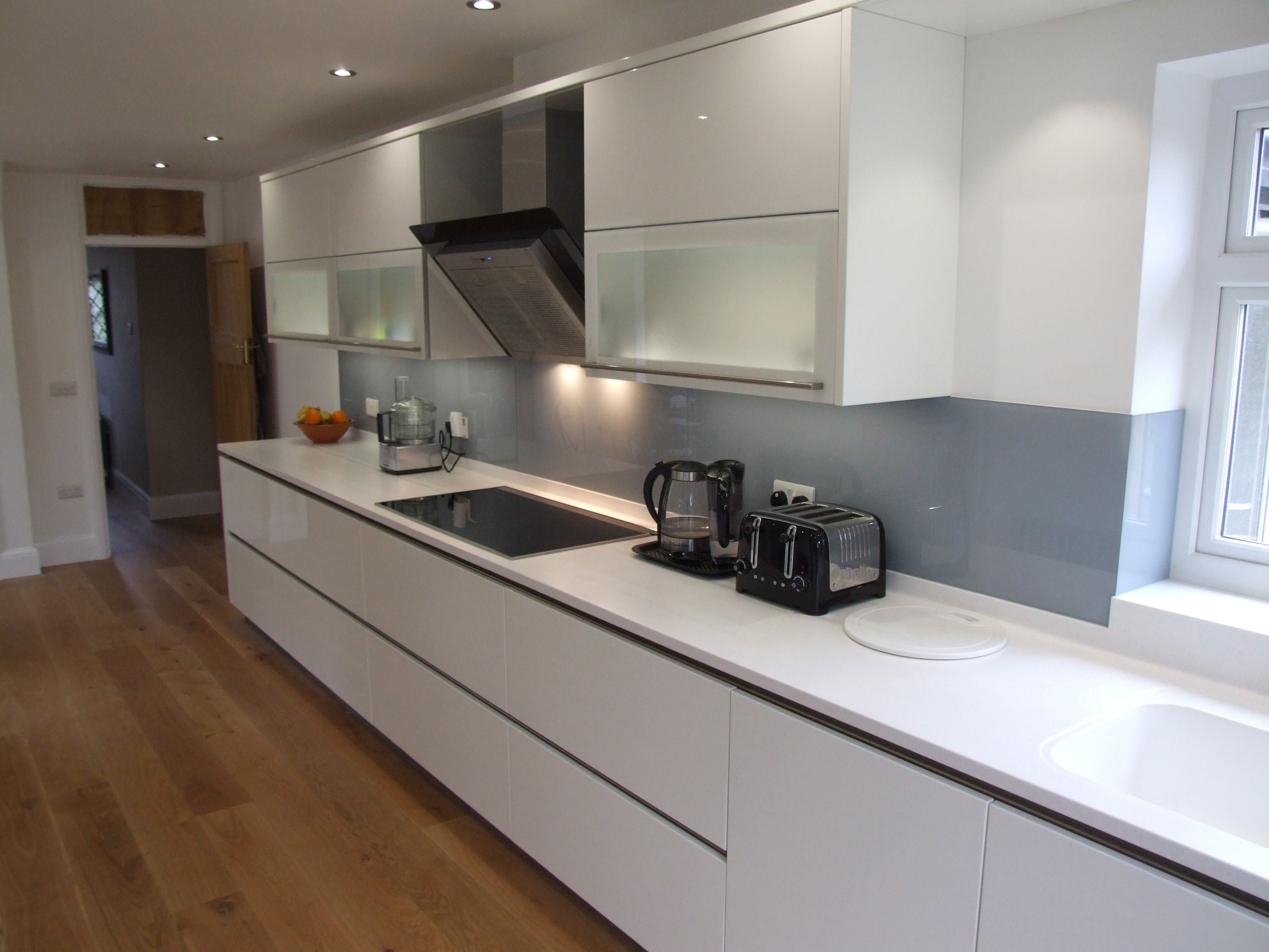 Best High Gloss White Cabinetry With Antarctica Corian Tops 640 x 480