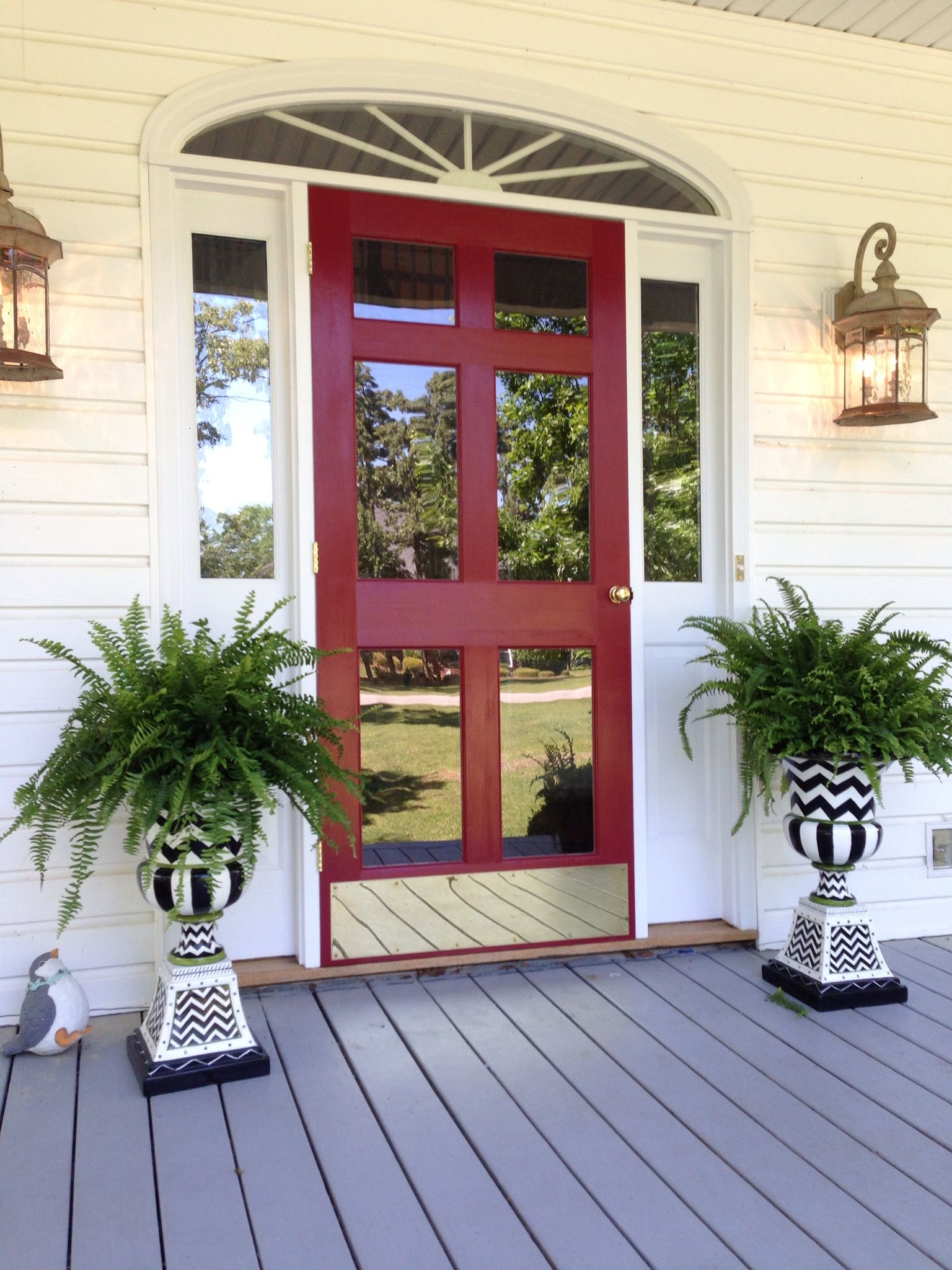 Front door and storm door painted red jle did this for a customer