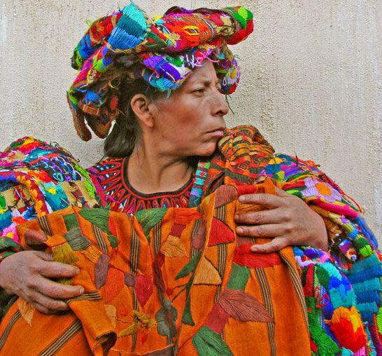 Mayan vendor; her beautiful clothing is striking, while her strong face and proud profile make her unforgettable.