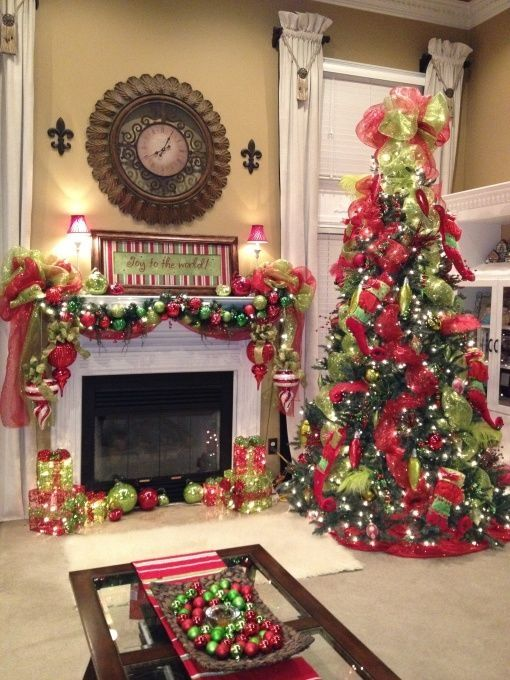 Fireplace Mantle and Christmas tree decorated with red and green - christmas fireplace decor