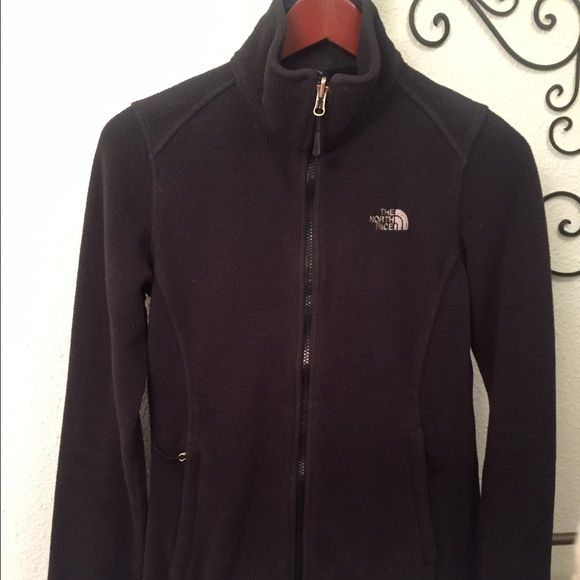 All black, fleece NorthFace jacket. This jacket is great for fall! It's nice and warm and cute. It is pilling, but I just had it dry cleaned. North Face Jackets & Coats