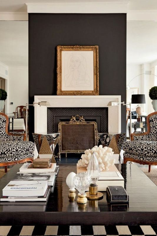 7 Color Combos Designers Swear By U2013 The Evans Edit   Black And White,  Striped Rug, Black Accent Wall, Ornate Gold Mirror Above Fireplace