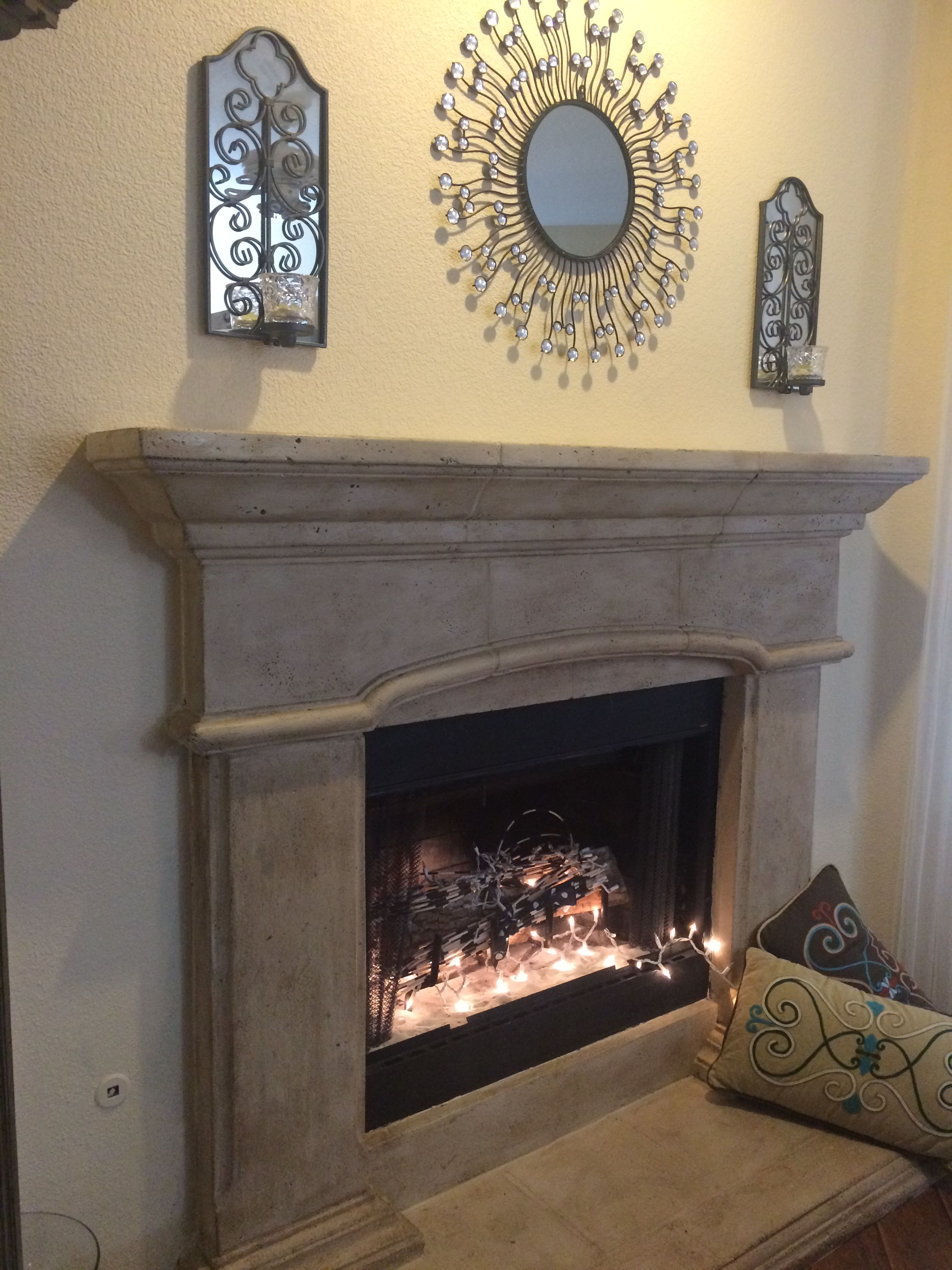 the brown had to go painting a cast stone fireplace surround with