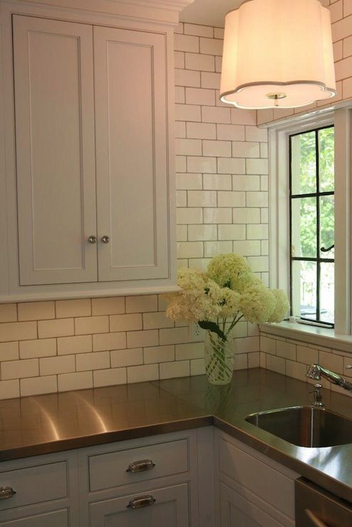 Butler's pantry with white shaker cabinets, stainless ...