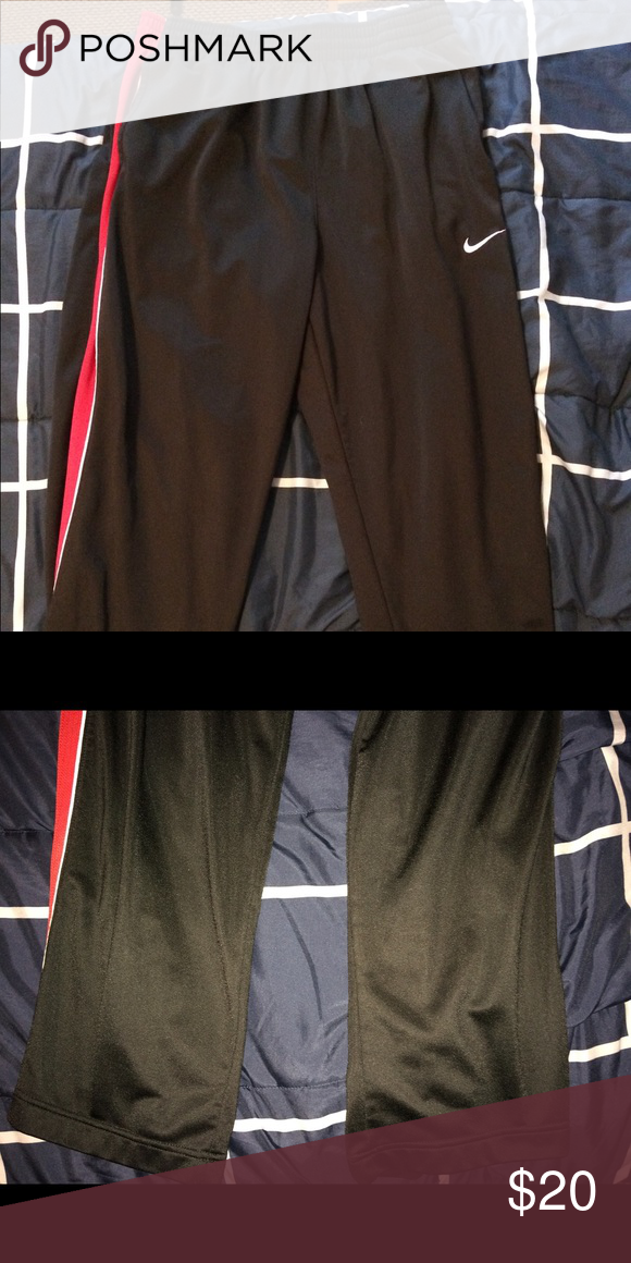 d3b52d44a Black Nike Men's Sweatpants Pair of black Nike sweatpants with red stripes  on the side. Size large. In great condition. No pets or smokers. $18 Nike  Pants ...