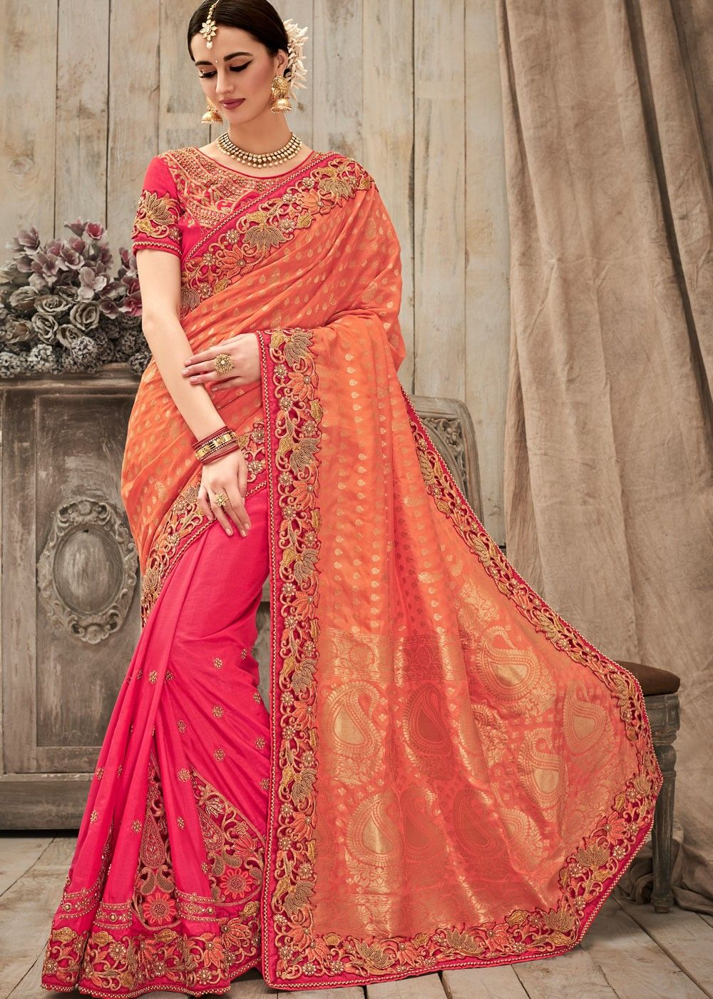 5325abd4a60486 Pink and orange half n half silk saree embellished with zari, beads work  and lace. Also comes with a red art silk blouse in similar work.