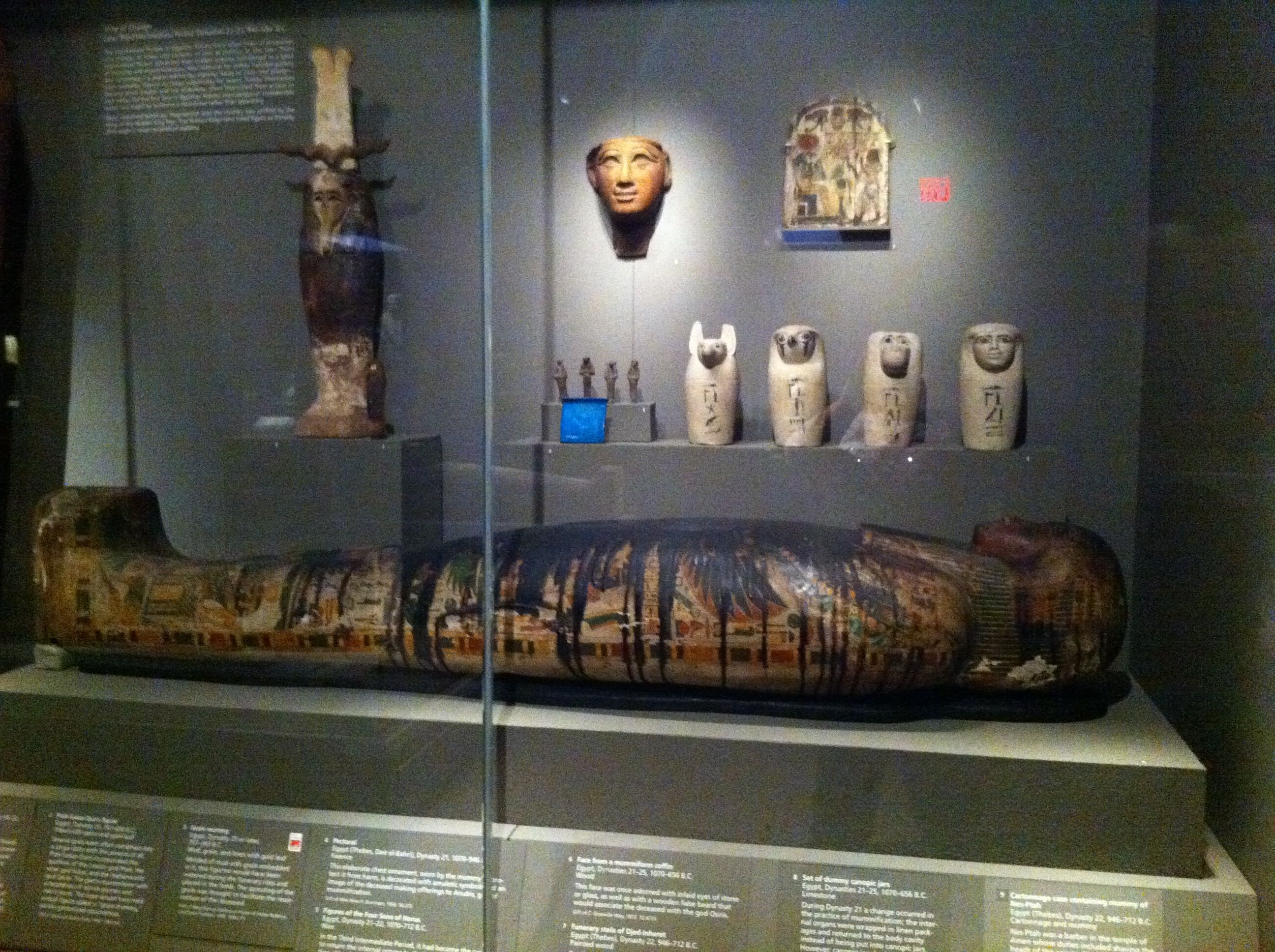 Egyptian Sarcophagus With Funerary Accessories. Boston