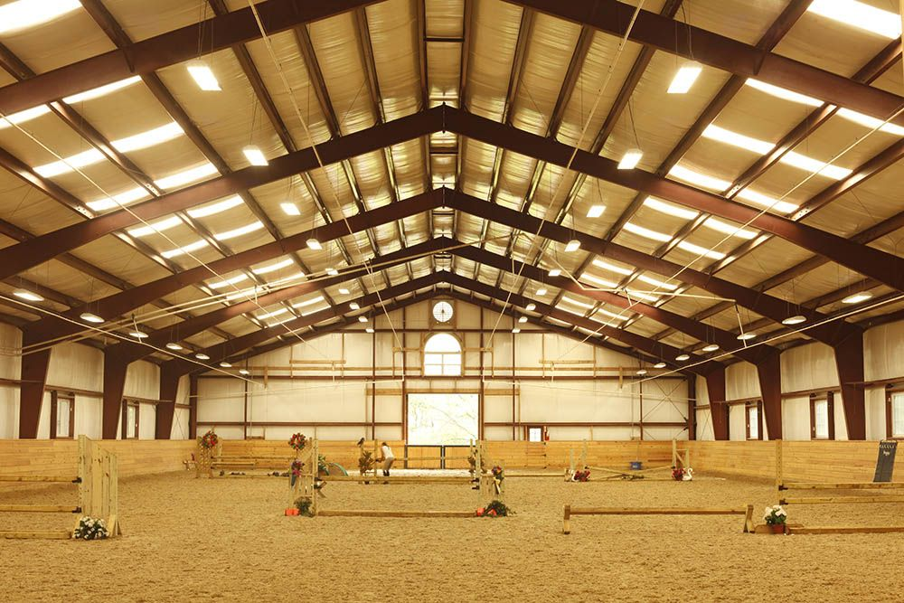 Metal clearspan riding arena with overhead misting system