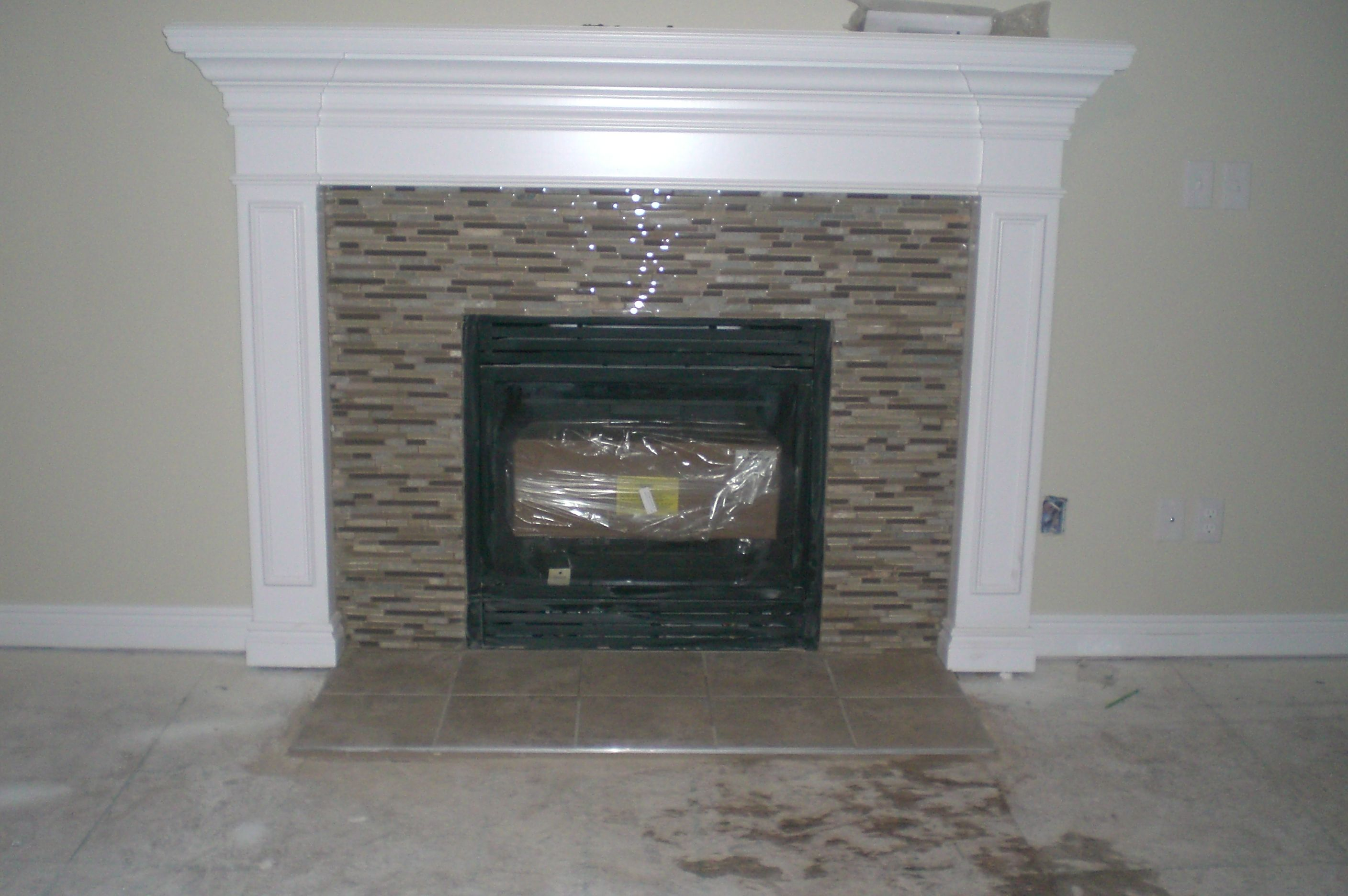 I had glassmosaic tile sheets used on our fireplace instead of i had glassmosaic tile sheets used on our fireplace instead of the standard ceramic tiles dailygadgetfo Gallery