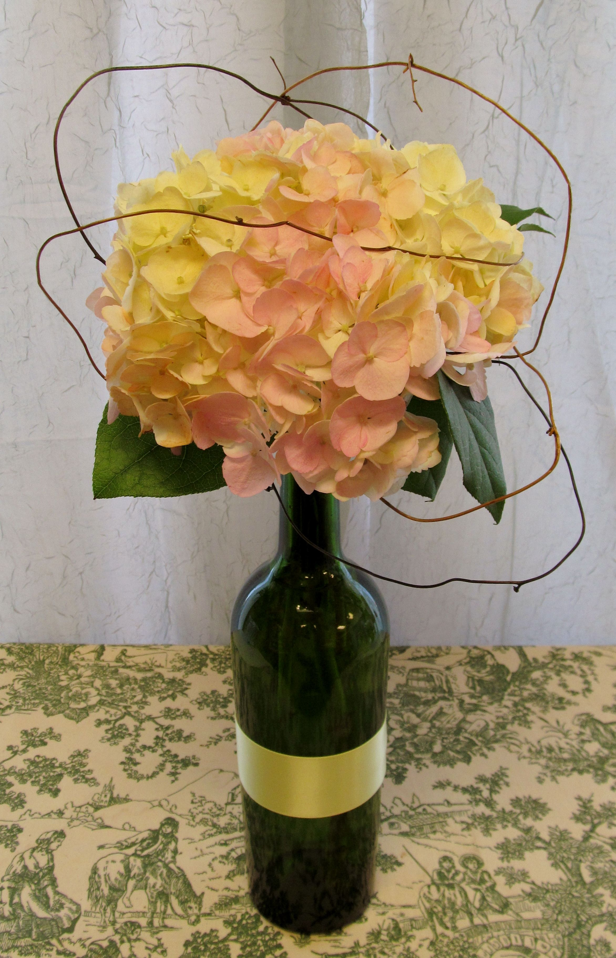 Wine Bottle Centerpiece Frosted With Crystals And Pearls White Flowers Blue Ribbon
