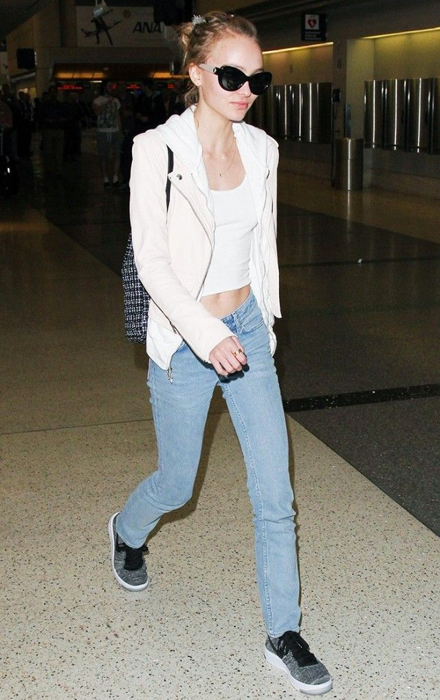53a0b264b551c2 Cool sneakers and a cropped tank make for a relaxed combination at the  airport. Lily