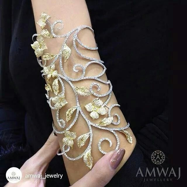 Exquisite, white and yellow bangle, shown at the International Jewellery Week, created with flair from Amwaj Jewellery.